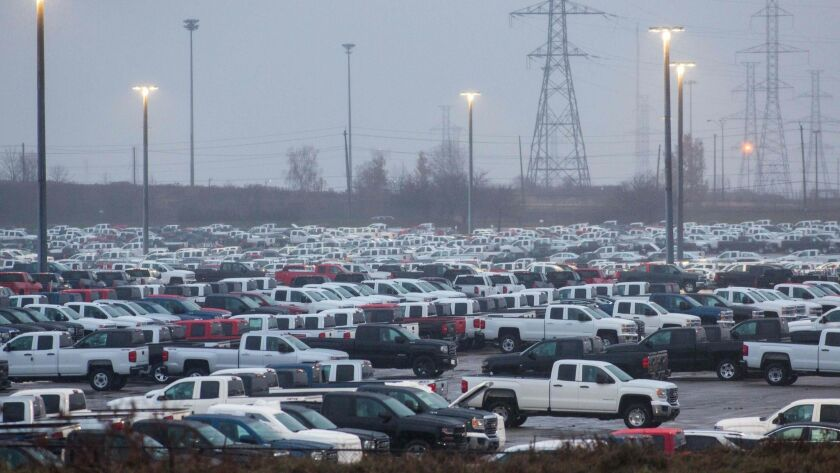 General Motors vehicles are parked outside the GM assembly plant in Oshawa, Canada.