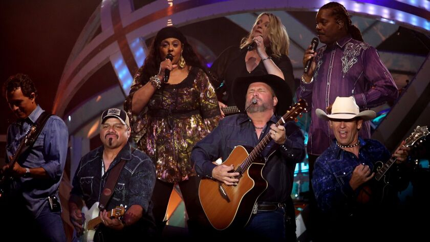 Garth Brooks, surrounded Saturday by members of his band, led a three-hour marathon show at the Forum in Inglewood, the last of four concerts at the arena on his 2017 world tour.