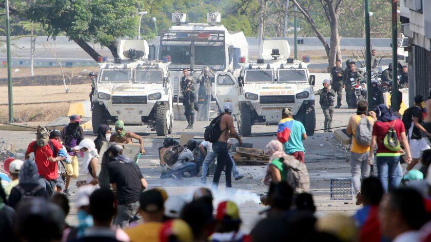 The Venezuelan national guard throws tear gas toward pro-Juan Guaido demonstrators after a May 1 demonstration at Plaza Altamira on May 1 in Caracas, Venezuela.