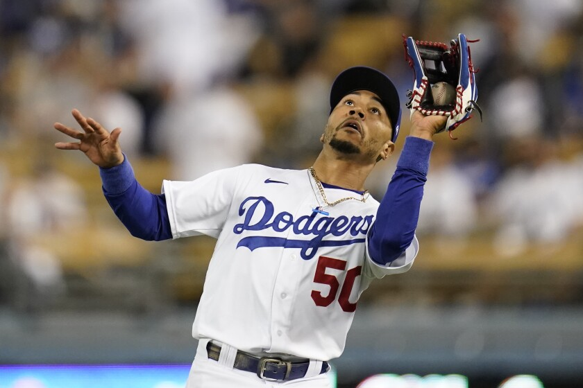 Los Angeles Dodgers right fielder Mookie Betts (50) catches a fly ball hit by San Diego Padres' Tommy Pham during the ninth inning of a baseball game Thursday, Sept. 30, 2021, in Los Angeles. (AP Photo/Ashley Landis)