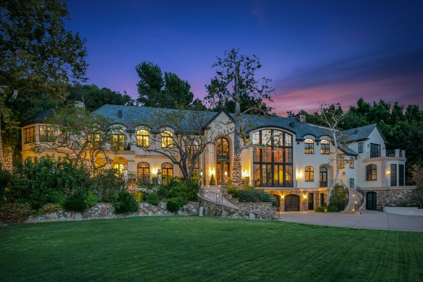 The compound includes a 13,400-square-foot mansion, tennis court and swimming pool.
