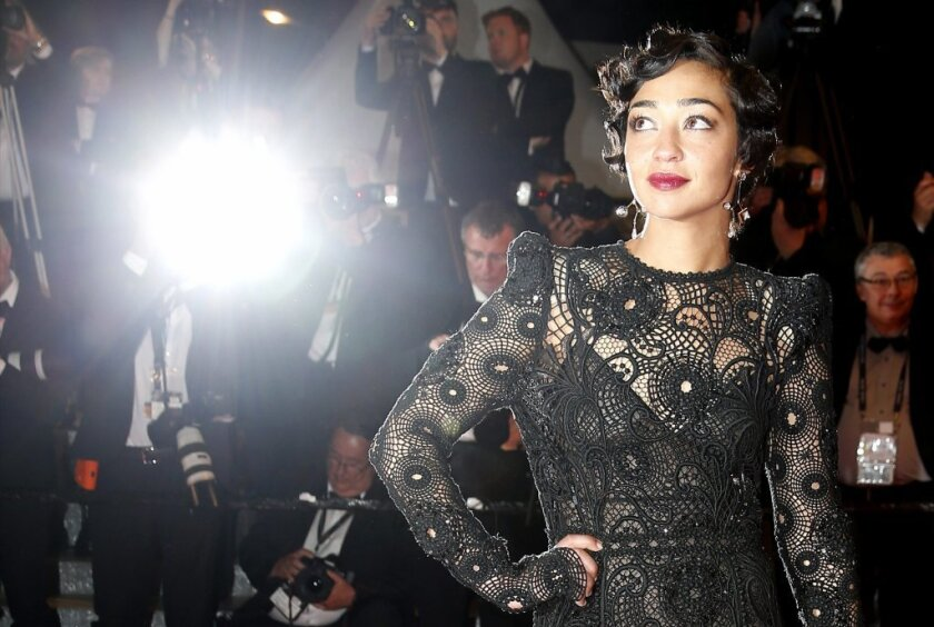 Ruth Negga, covered, but bare, made a stunning debut at the 2016 Cannes Film Festival in a sheer, black lace gown by Marc Jacobs.