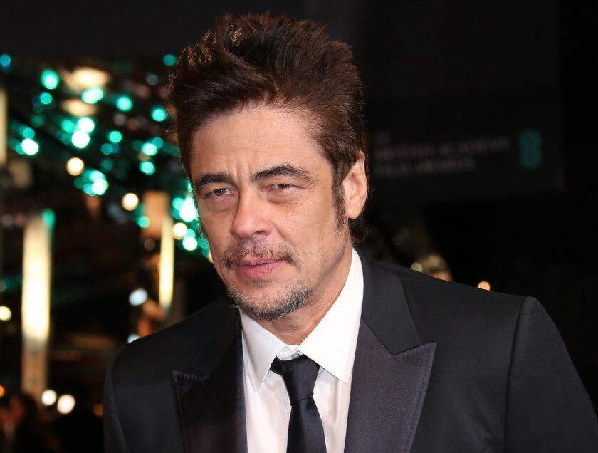 "FILE - In this Sunday, Feb. 14, 2016, file photo, actor Benicio Del Toro poses for photographers upon arrival at the BAFTA 2016 film awards at the Royal Opera House in London. ""Star Wars: Episode VIII"" has begun filming and has added Del Toro and Laura Dern to its cast. The Walt Disney Co. announce"