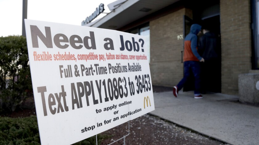 Customers enter a McDonald's restaurant near an employment sign visible, Thursday, Jan. 3, 2019, in