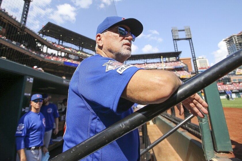 Joe Maddon looks out from the dugout prior to a game between the Chicago Cubs and St. Louis Cardinals on Sept. 29  in St. Louis.