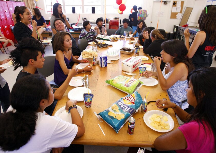 Grethel Gahbler, 17, (left center, seated) celebrated her birthday at Castle Park High School. Another Castle Park student, Regil Abagat, was awarded the party for his achievements at school and gave the party to Grethel. (K.C. Alfred / Union-Tribune)