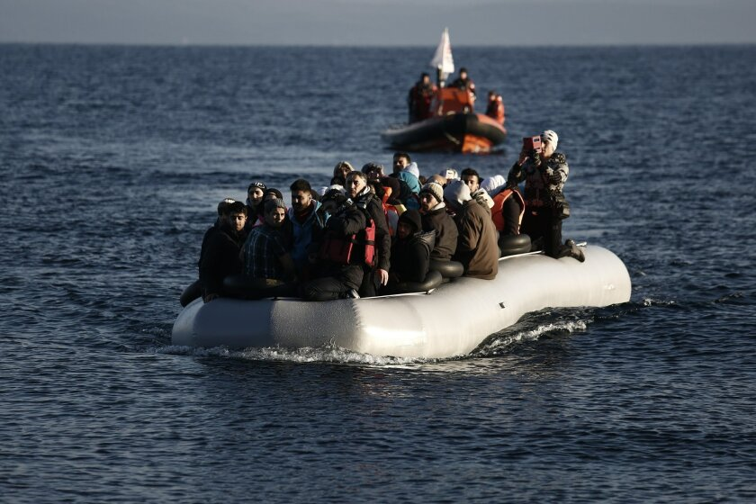 Refugees and migrants arrive on a dinghy from the Turkish coast to the northeastern Greek island of Lesbos, on Tuesday, Feb. 9 2016. The International Organization for Migration says Mediterranean crossings in the first six weeks of this year are running at nearly ten times the rate in the same per