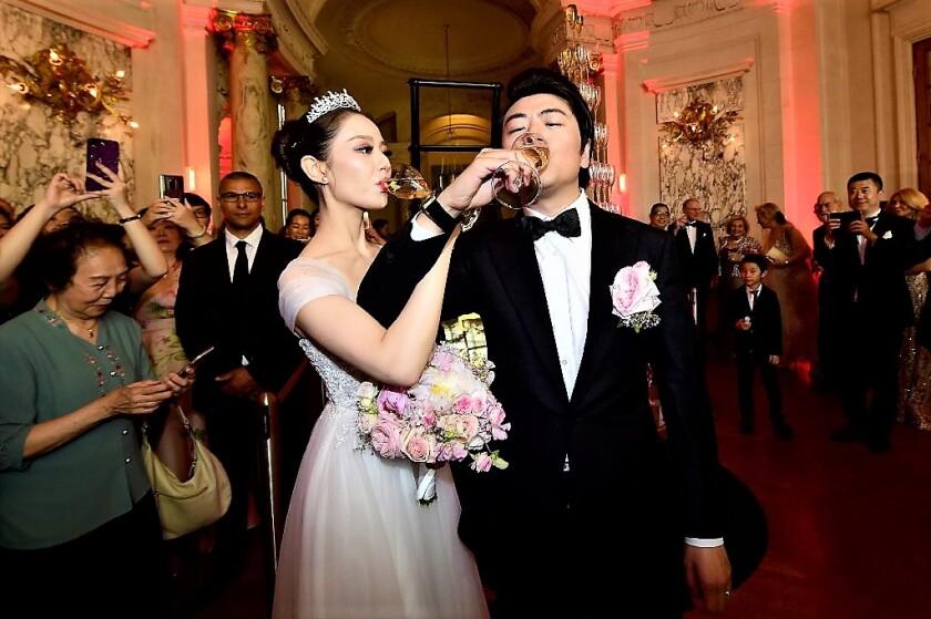 Lang Lang and bride Gina Alice, Getty Images.JPG