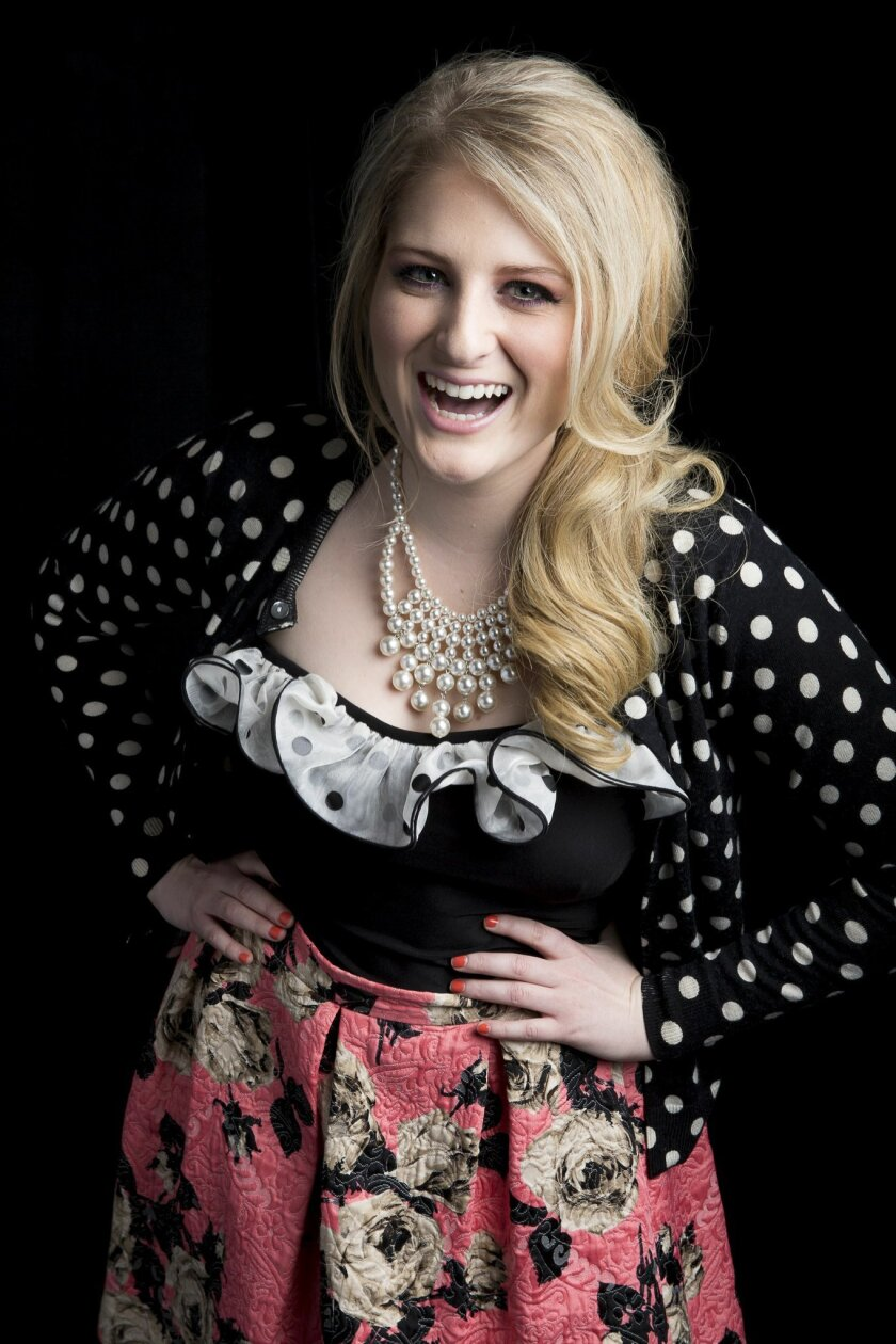 """American singer-songwriter Meghan Trainor, known for the pop single """"All About That Bass,"""" poses for a portrait, on Thursday, Aug. 7, 2014 in New York. (Photo by Amy Sussman/Invision/AP)"""