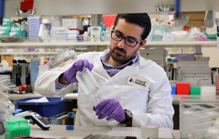 In a lab at Ionis Pharmaceuticals temporary scientist Ben Kiaei works with extracted RNA from tissue samples. He's working on the Neuroscience Drug Discovery team to develop therapies for diseases of the central nervous system.