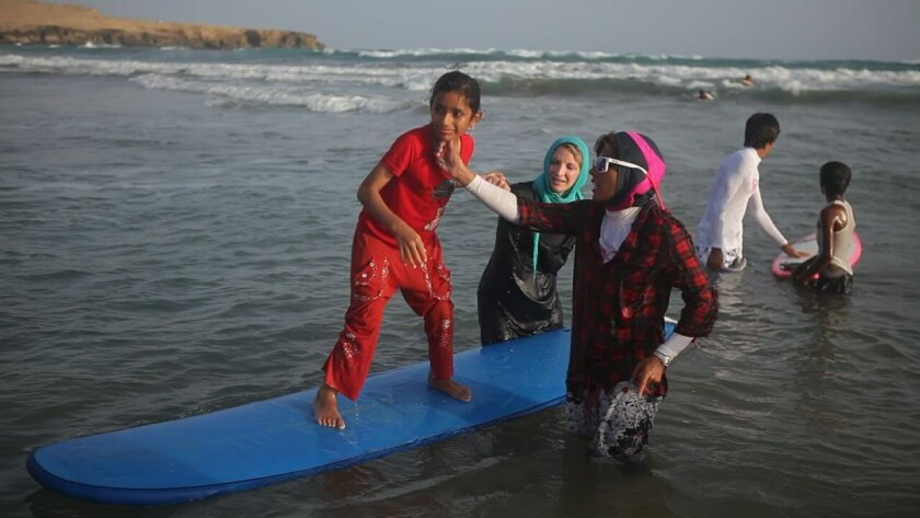 A scene from French director Marion Poizeau's documentary, 'into the Sea,' which chronicles the journey of three women: an Irish surfer, Iranian snowboarder and Iranian diver who are introducing the sport of surfing to Iranian men and women. The film will have its U.S. premiere 8 p.m. Friday May 22