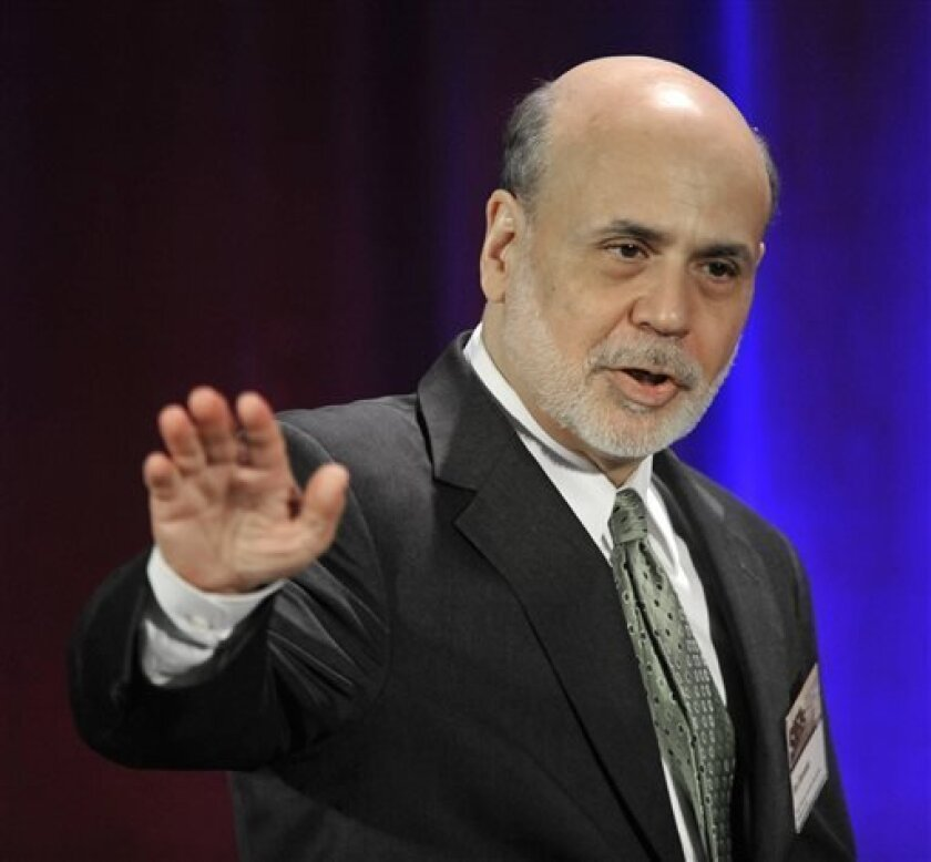 Federal Reserve Chairman Ben Bernanke waves goodbye after speaking during a banking conference in Chicago, Friday, May 10, 2013. The Federal Reserve has broadened its oversight beyond banks and now monitors a wide-range of financial institutions that could hasten another financial crisis, Bernanke said Friday. (AP Photo/Paul Beaty)