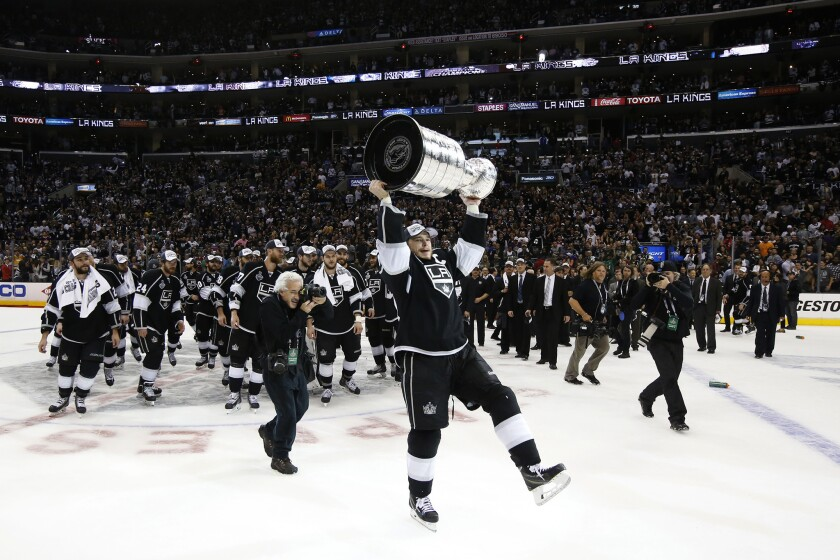 Kings captain Dustin Brown skates with the Stanley Cup on June 13, 2014.