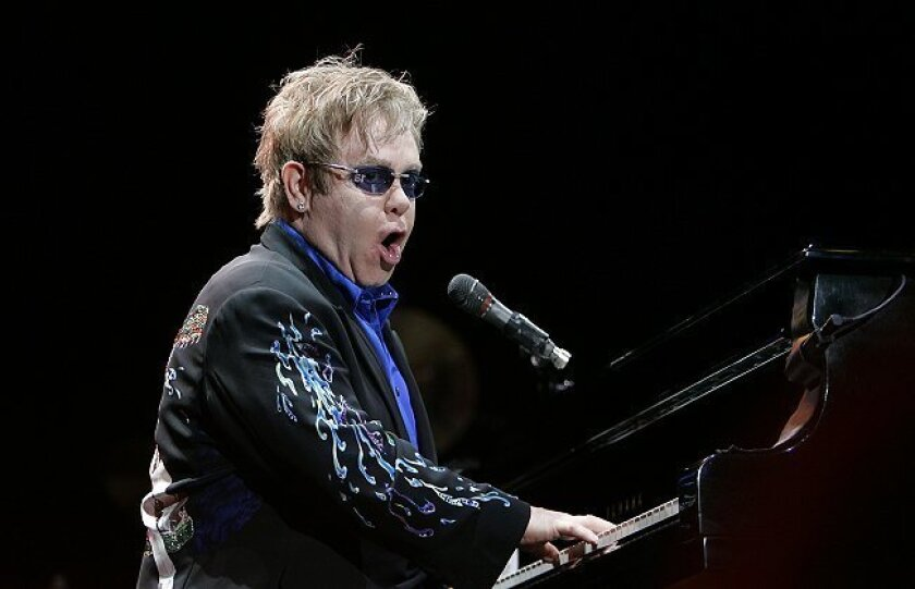 """Elton John belts out """"Funeral for a Friend/Loves Lies Bleeding"""" during the opening salvo of his well-received concert at Cricket Wireless Amphitheatre Saturday night."""
