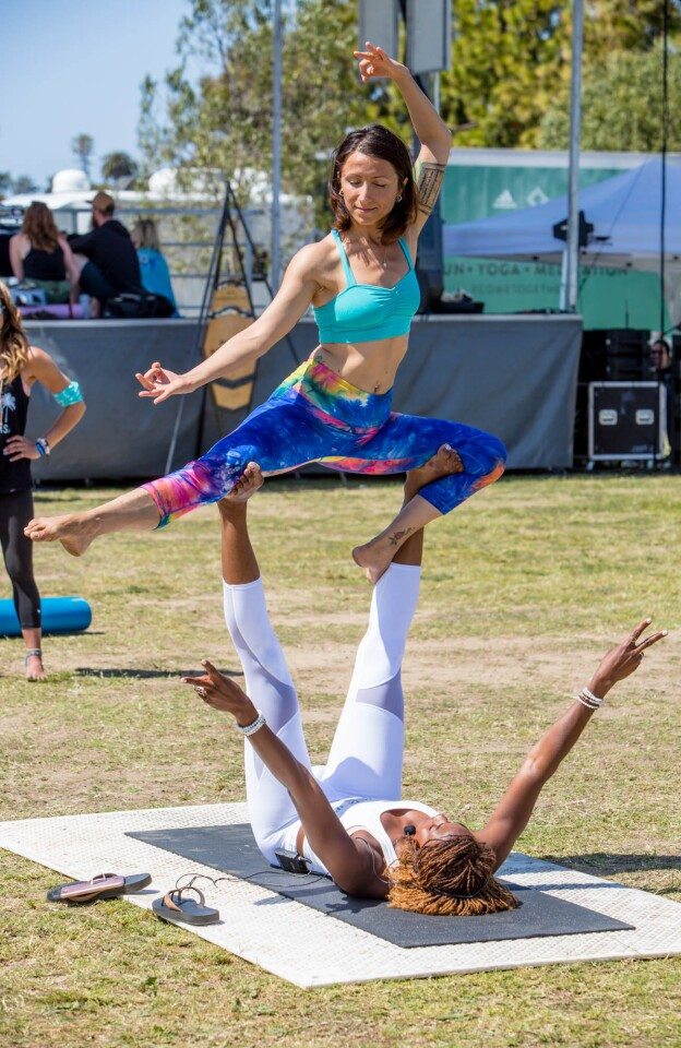 It was a peaceful Saturday at Liberty Station as participants of Wanderlust 108 took part in a day of yoga and meditation on Saturday, April 15, 2017. (Bradley Schweit)
