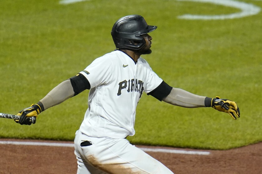 Pittsburgh Pirates' Gregory Polanco follows through on a sacrifice fly off San Francisco Giants relief pitcher Caleb Baragar that drove in the winning run during the 11th inning of a baseball game in Pittsburgh, Friday, May 14, 2021. The Pirates won 3-2. (AP Photo/Gene J. Puskar)