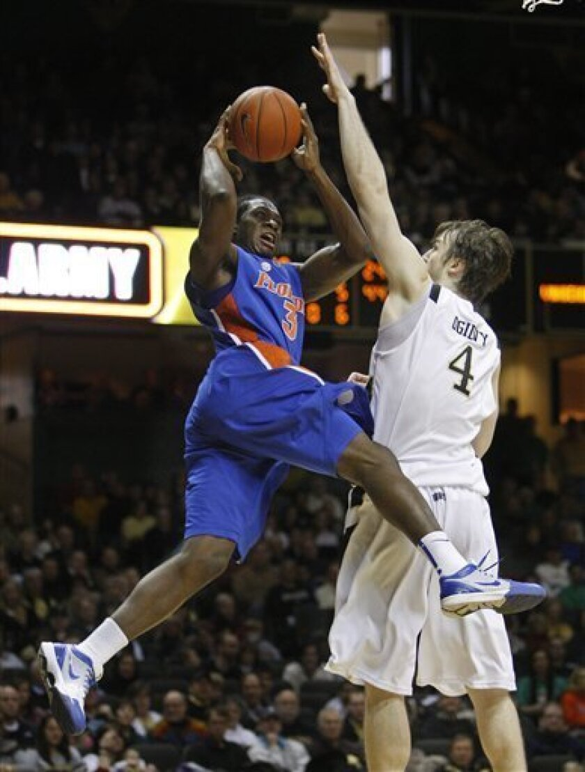 Florida's Ray Shipman (3) drives against Vanderbilt center A. J. Ogilvy (4) during the first half of an NCAA basketball game on Saturday, Jan. 9, 2010 in Nashville, Tenn. (AP Photo/Mark Humphrey)