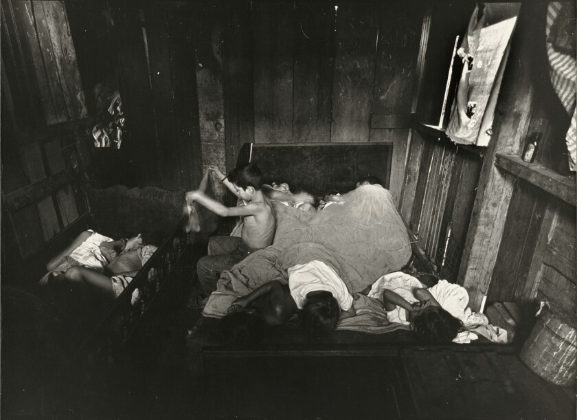 """The 1961 photograph """"Family's Day Begins, Rio de Janeiro, Brazil"""" is among the works on display in the new exhibit """"Gordon Parks: The Flávio Story"""" at the Getty."""