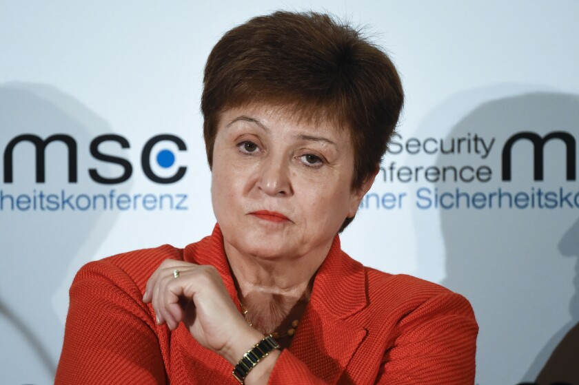 "FILE - In this Feb. 14, 2020, file photo, Kristalina Georgieva, Managing Director of the International Monetary Fund, attends a session on the first day of the Munich Security Conference in Munich, Germany. Georgieva said that the global economy has started on a long climb to stronger growth with prospects looking a little better than four months ago. Georgieva said Tuesday, Oct. 6 that global economic activity suffered an unprecedented fall in the spring when 85% of the global economy was in lockdown for several weeks but currently the situation is ""less dire"" with many countries seeing better-than-expected rebounds in recent weeks (AP Photo/Jens Meyer, File)"