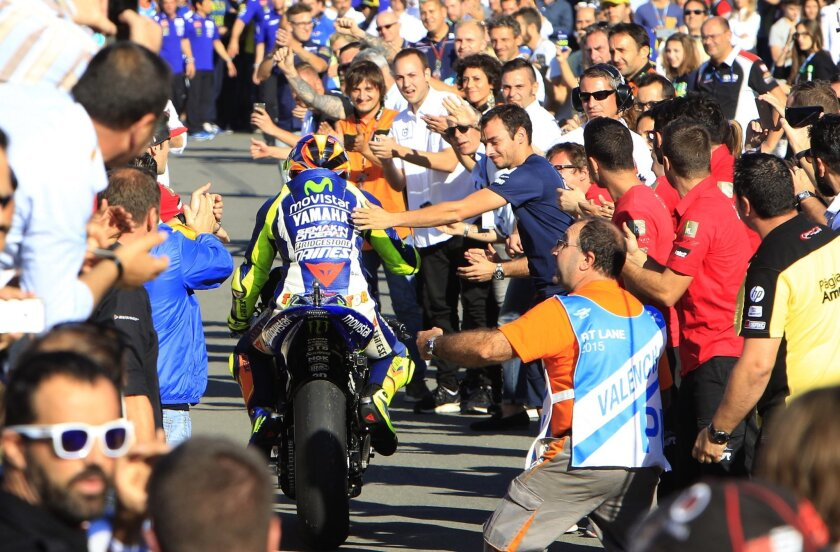 MotoGP rider Valentino Rossi of Italy arrives fourth during the Valencia Motorcycle Grand Prix, the last race of the season, at the Ricardo Tormo circuit in Cheste near Valencia, Spain, Sunday, Nov. 8, 2015. (AP Photo/Alberto Saiz)