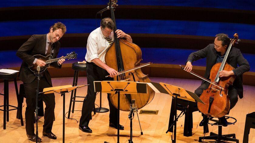 Mandolinist Chris Thile, from left, bassist Edgar Meyer and cellist Yo-Yo Ma perform Bach trios at Walt Disney Concert Hall on Wednesday.