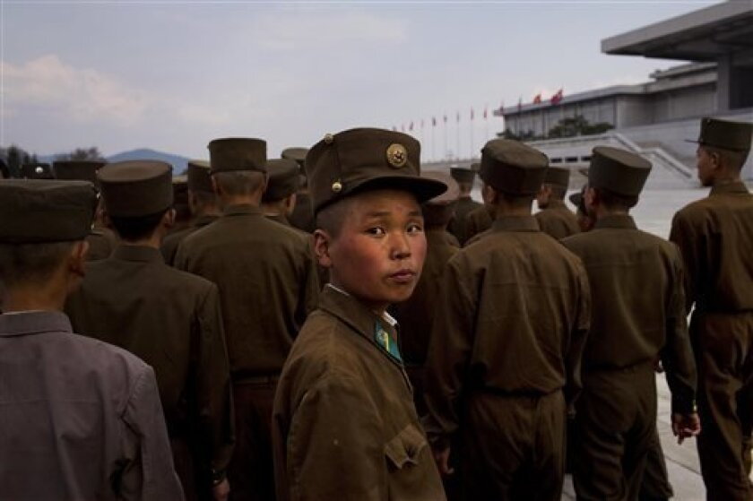 North Korean soldiers tour the park surrounding Kumsusan Palace of the Sun, the mausoleum where the bodies of the late leaders Kim Il Sung and Kim Jong Il lie embalmed, in Pyongyang on Thursday, April 25, 2013. North Korea on Thursday marked the 81st anniversary of the founding of its military, whi