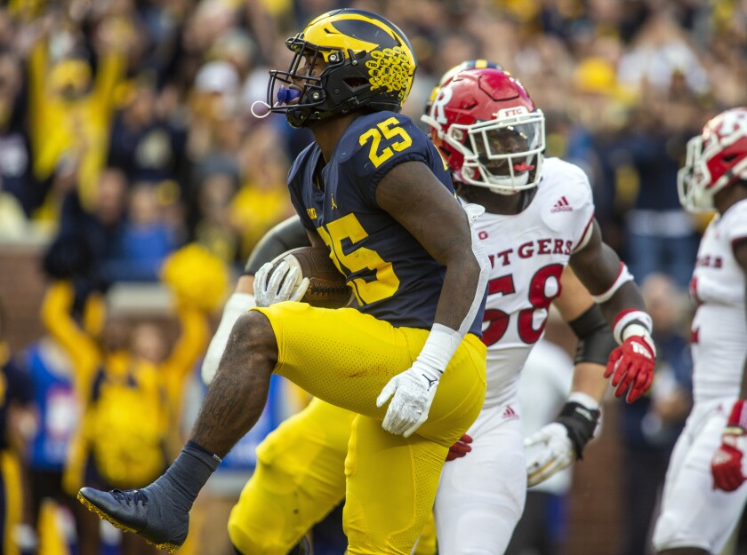 Michigan running back Hassan Haskins (25) celebrates after scoring a touchdown in the second quarter of an NCAA college football game against Rutgers in Ann Arbor, Mich., Saturday, Sept. 25, 2021. (AP Photo/Tony Ding)