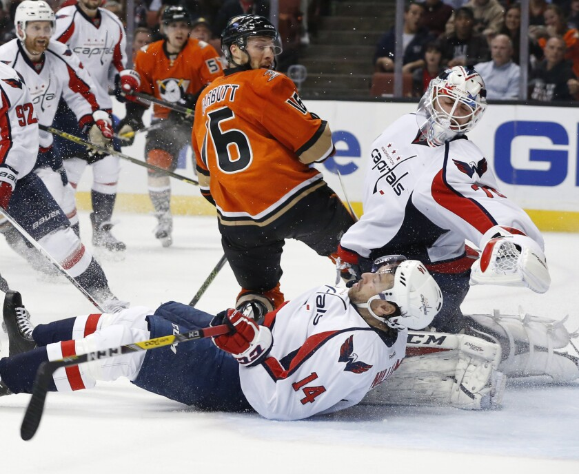 Ducks forward Ryan Garbutt (16) collides with Capitals forward Justin Williams (14) as Capitals goalie Braden Holtby (70) manages to keep the Ducks from scoring in the second period.