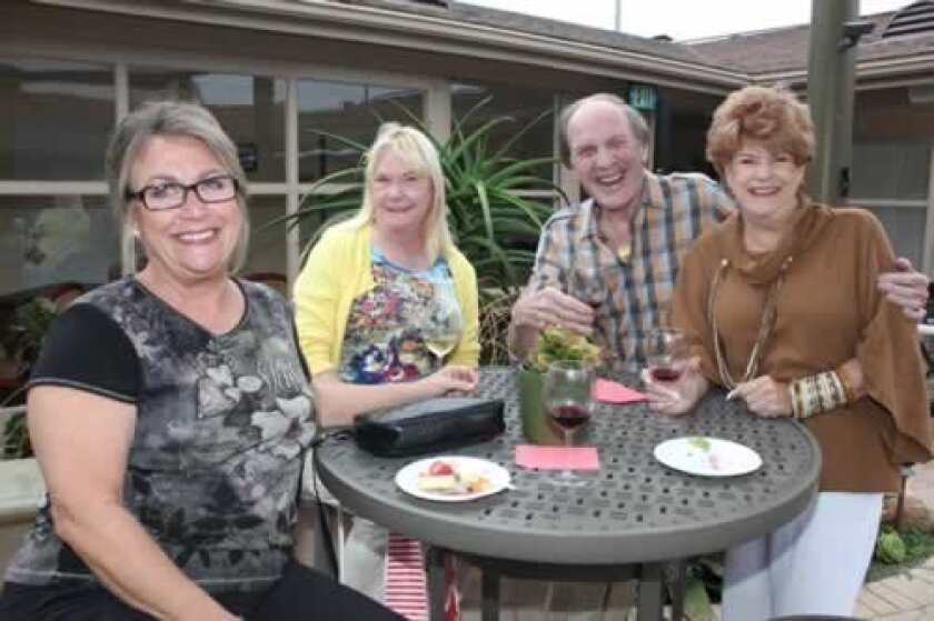 Bobbie Backer, Lynn Smith, Charlie Larson and Kathryn Annelli at the La Jolla Community Center's Aug. 24 wine-tasting fundraiser.