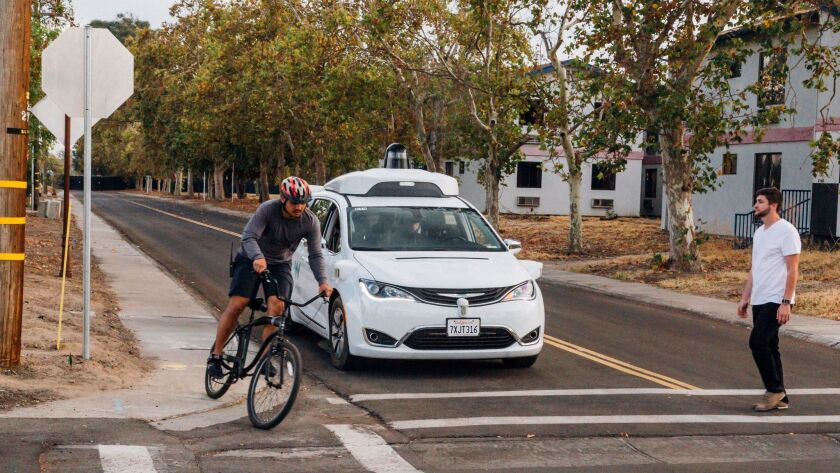 This Sunday, Oct. 29, 2017, photo provided by Waymo shows a Chrysler Pacifica minivan equipped with