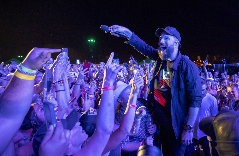 INDIO, CALIF. -- SATURDAY, APRIL 27, 2019: After climbing off stage, Saturday?s headliner Sam Hunt