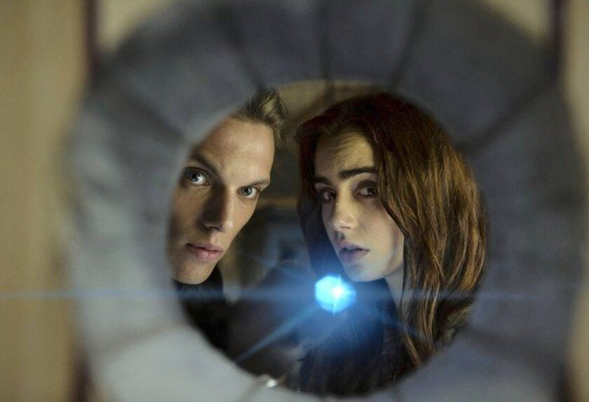 """Jamie Campbell Bower and Lily Collins star in """"The Mortal Instruments: City of Bones."""""""