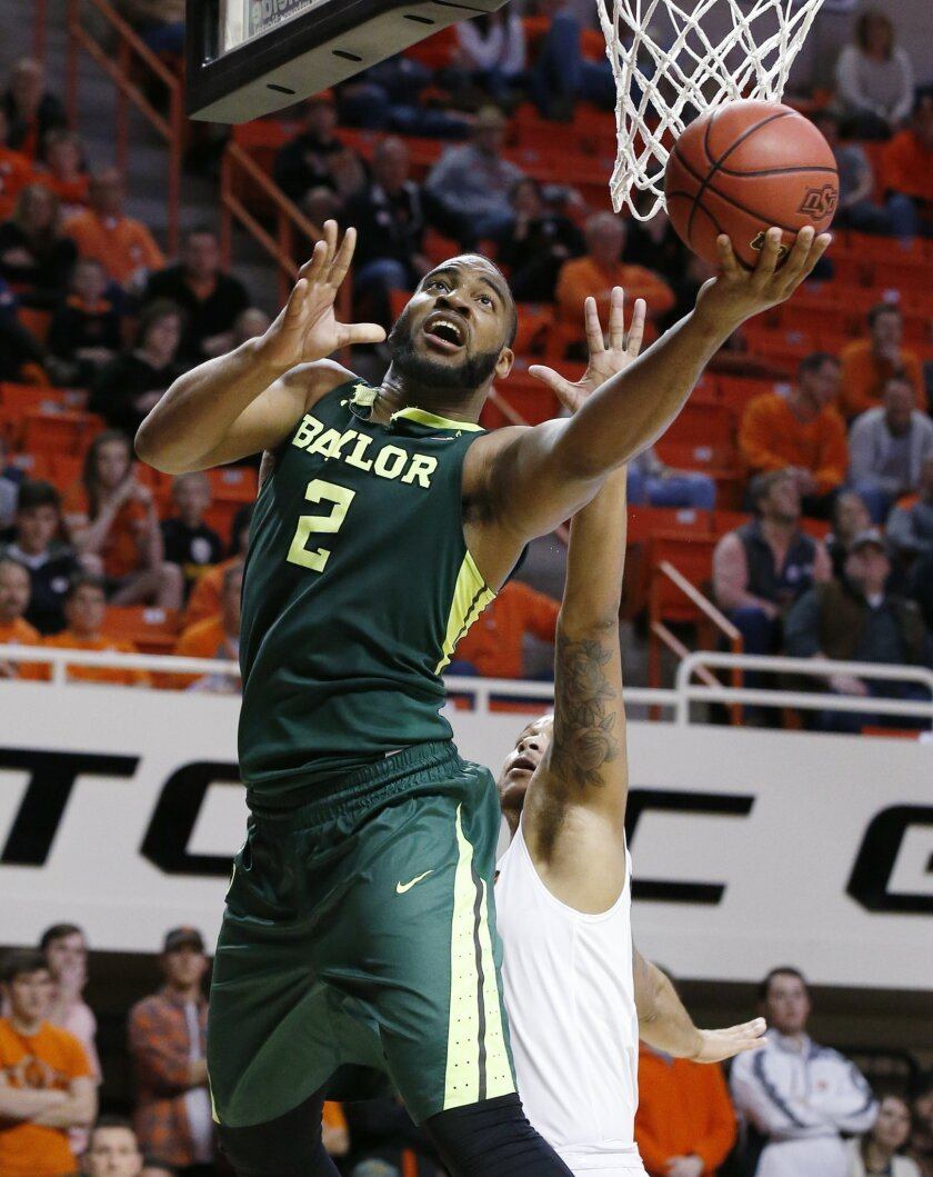 Baylor forward Rico Gathers (2) shoots in front of Oklahoma State forward Chris Olivier, right, during the second half of an NCAA college basketball game in Stillwater, Okla., Wednesday, Jan. 27, 2016. Baylor won 69-65. (AP Photo/Sue Ogrocki)