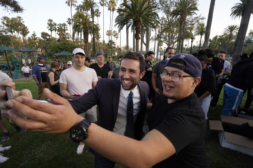Kevin Paffrath poses for a selfie at a rally at L.A.'s Echo Park Lake