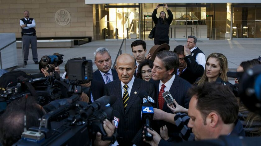 Former Los Angeles County Sheriff Lee Baca, left and attorney Nathan Hochman talk to reporters outside federal court Thursday, in downtown Los Angeles.