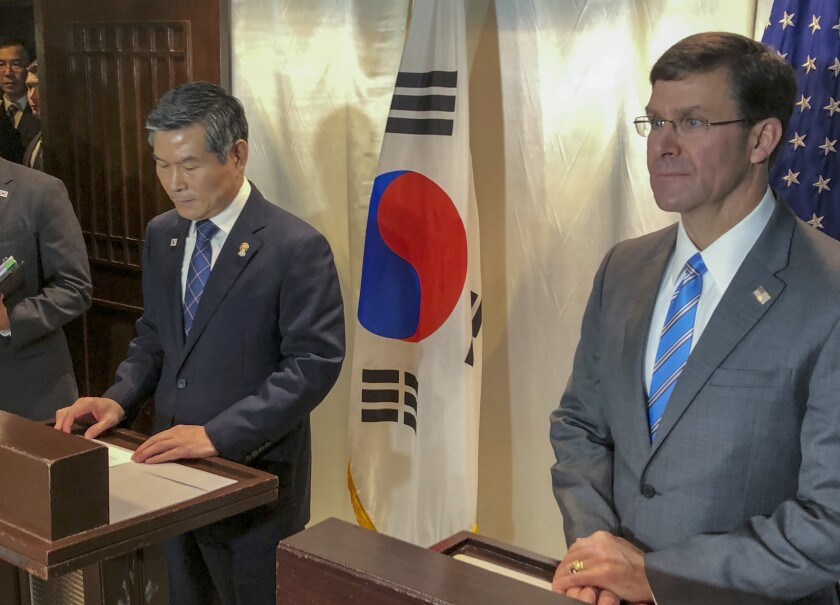 U.S. Defense Secretary Mark Esper, right, and his South Korean counterpart, Jeong Kyeong-doo, in Bangkok