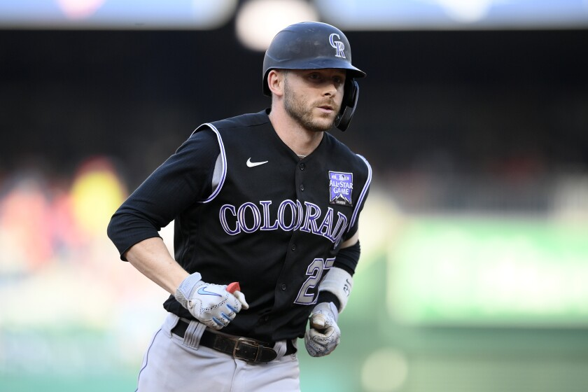 Colorado Rockies' Trevor Story rounds the bases on his three-run home run during the fourth inning of a baseball game against the Washington Nationals, Saturday, Sept. 18, 2021, in Washington. (AP Photo/Nick Wass)