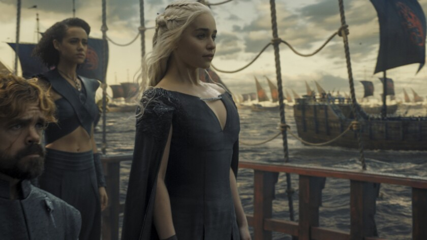 """Emilia Clarke, right, Nathalie Emmanuel and Peter Dinklage in """"Game of Thrones."""""""
