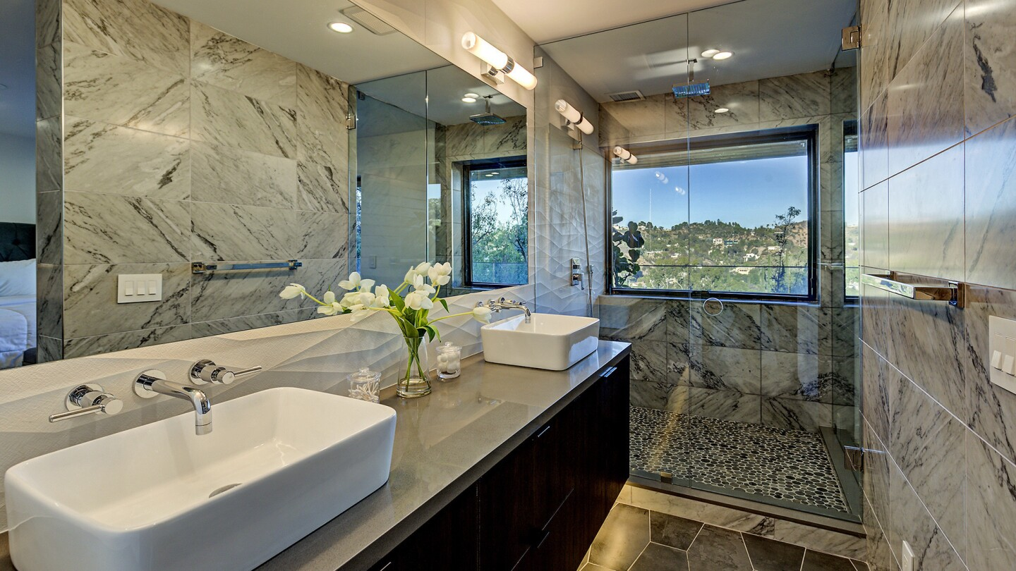 Renovations include modern fixtures and countertops.