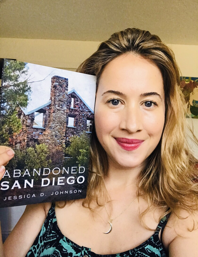 """Author Jessica Johnson with her book """"Abandoned San Diego"""""""