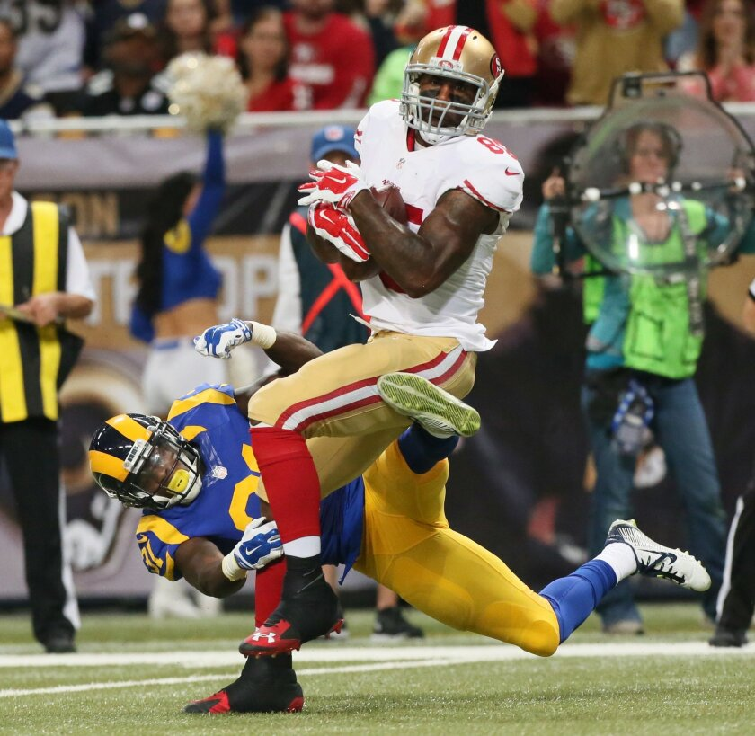 San Francisco 49ers tight end Vernon Davis tries to break free of a tackle by St. Louis Rams safety Maurice Alexander on a reception during an NFL football game Sunday, Nov. 1, 2015, in St. Louis. (Chris Lee/St. Louis Post-Dispatch via AP)  EDWARDSVILLE INTELLIGENCER OUT; THE ALTON TELEGRAPH OUT; M