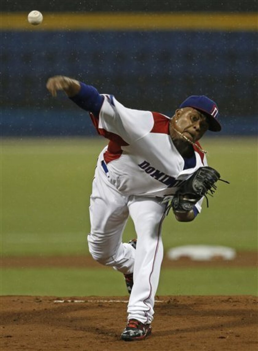 Dominican Republic's starting pitcher Edinson Volquez throws in the first inning of the World Baseball Classic first round game against Venezuela in San Juan, Puerto Rico, Thursday, March 7, 2013. (AP Photo/Andres Leighton)