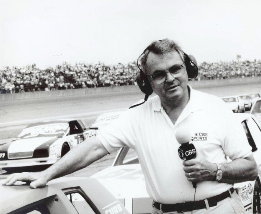 Chris Economaki, shown at Daytona International Speedway in Daytona Beach, Fla., was regarded as the authoritative voice in motor sports for decades.