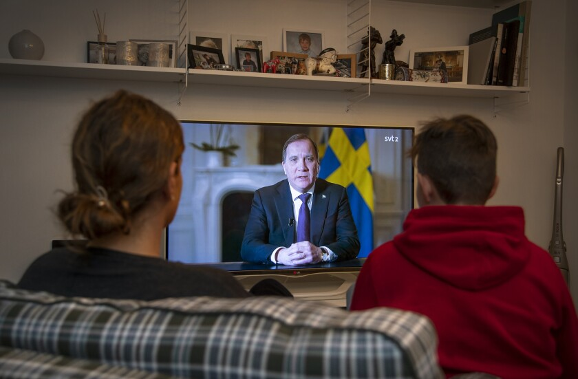 Swedish Prime Minister Stefan Lofven addresses the nation on TV.