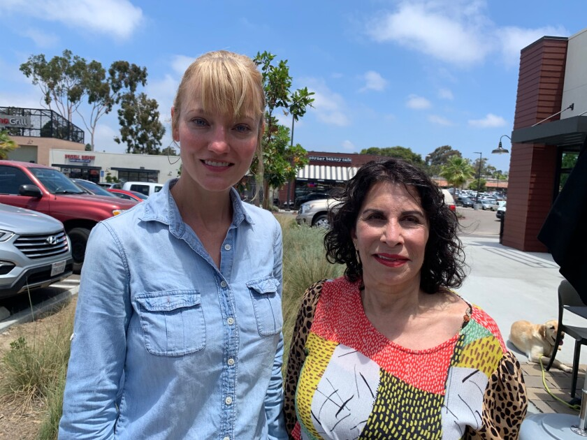 Encinitas residents Alissa Daulat, left, and Ronnie Steinau, are spreading the word about the threat of poisoning posed by sago palms, especially to pets.<br>