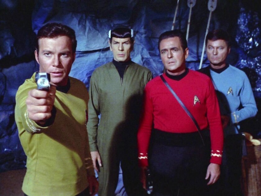 "William Shatner as Capt. James T. Kirk, left, Leonard Nimoy as Mr. Spock, James Doohan as Montgomery ""Scotty"" Scott and DeForest Kelley as Dr. Leonard ""Bones"" McCoy in ""Star Trek."""