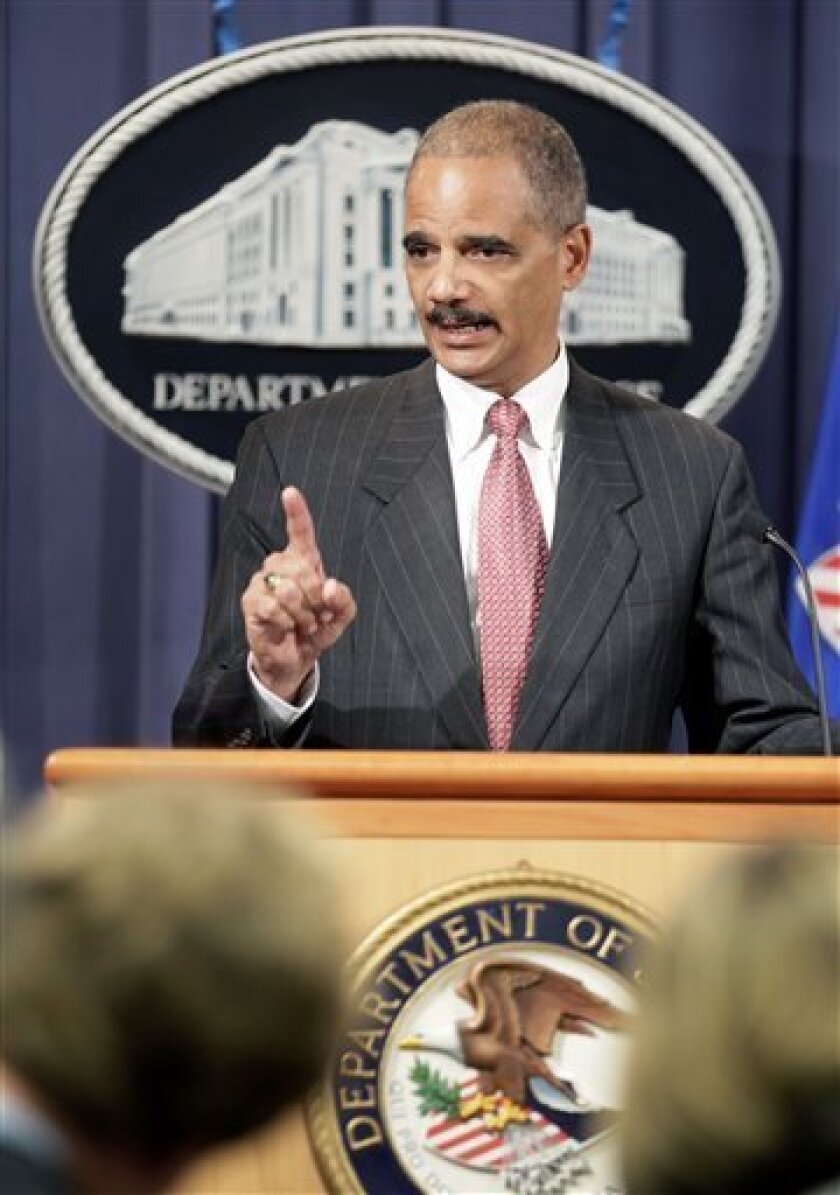 Attorney General Eric Holder speaks during a news conference at the Justice Department in Washington, Monday, Oct. 4, 2010. (AP Photo/Carolyn Kaster)