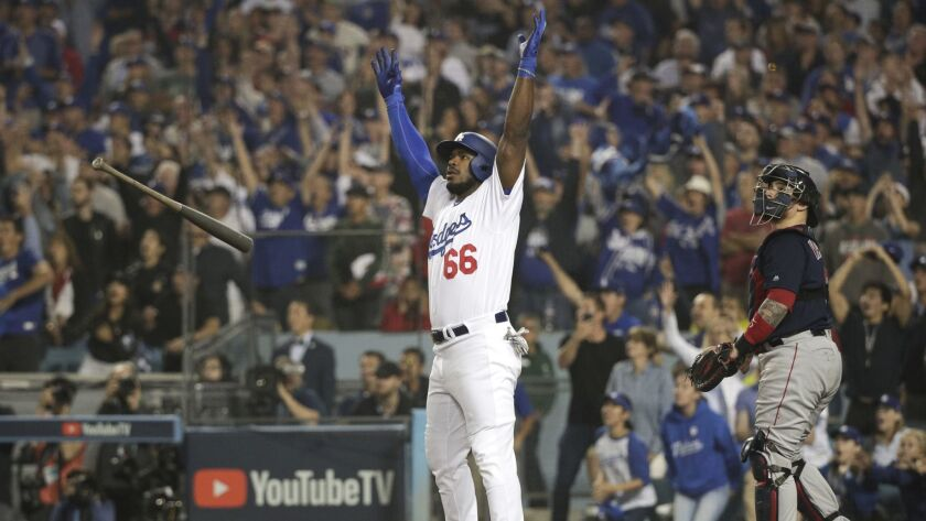 Los Angeles Dodgers' Yasiel Puig celebrates after his three-run home run against the Boston Red Sox