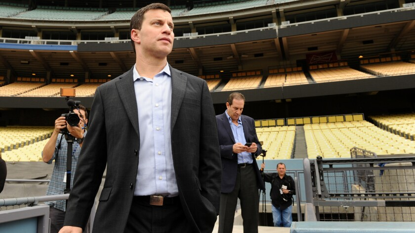 Andrew Friedman, the Dodgers newly appointed President of Baseball Operations, looks on while standing in Dodger Stadium before a news conference in October.