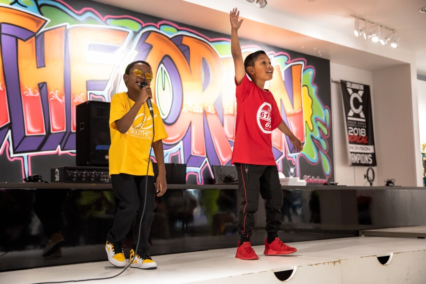 J-Movell'e Brown, 6, and Aaron Hernandez, 10, performed at the Youth Hip Hop Leadership Summit on June 5.